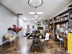 Jewelry designer Ippolita Rostagno's home office occupies the top floor of her Brooklyn brownstone; the pendant lamps are by RH, the custom-made oak cabinetry has pulls by Rocky Mountain Hardware, and the tables display an array of Ippolita jewelry and accessories | archdigest.com