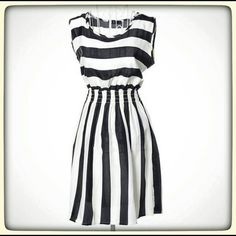 Bohemian black & white dress Bohemian black and white diagonal striped dress. Tag says large but it fits like a small. NWOT. My price is firm. Would best fit sizes 2/4. Dresses Midi