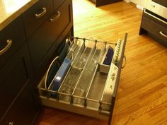 kitchen storage solutions, drawer organizers and dividers, pull-outs, etc.