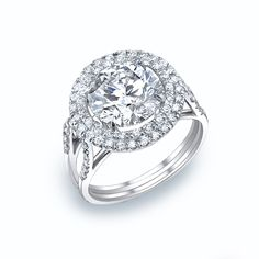Our vintage inspired design featuring a double diamond halo. This ring can be modified. #michaelscreativejewelry #diamondengagementring