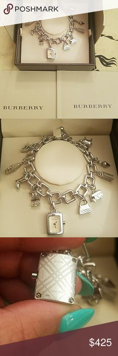Burberry CHARM BRACELET WATCH Loudon ED BU5200 Beautiful charm bracelet watch, no missing charms, needs battery,  box, manual included.  This Charm Bracelet includes some of Londons most iconic items like the Route Master Bus, the Red Telephone box, Big Ben, Umbrella, Sheep, Guard uniform, Union Jack Flag, Boot, Handbag and then toped with the Burburry B Font.  Watch Charm bracelet lenght : 20.4mm   Outer box is ripped/damaged on one side. Reg box is ok. Burberry Accessories Watches