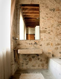 a French farmhouse bathroom with stone walls and a stone sink attached to the wall is very pretty Stone Bathroom, Bathroom Sinks, Bathtub, Rustic Stone, Stone Sink, Rustic Bathrooms, Modern Bathrooms, Stone Houses, French Farmhouse
