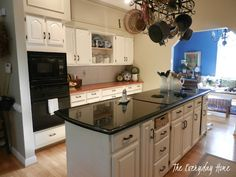 colorful kitchen turned white - great makeover!