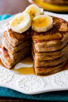 Simple Whole Wheat Banana Pancakes made with Greek yogurt, banana, whole wheat flour, and not much else! Recipe on sallysbakingaddiction.com