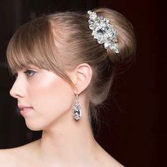 Erin Cole designer hair accessories. Crystal bridal hair comb with large teardrop center. A unique piece for the contemporary bride.