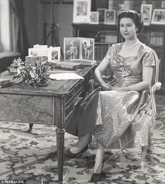 Historic: The Queen is pictured in the Long Library at Sandringham House following her first televised Christmas Day message in 1957.