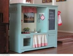 Outdated entertainment center repurposed into kids children's play kitchen; Upcycle, recycle, salvage, diy, repurpose!  For ideas and goods shop at Estate ReSale & ReDesign, Bonita Springs, FL