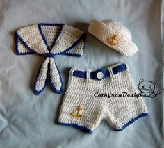 Little sailor hat, collar and shorts/diaper cover with buttons at legs for easy change.