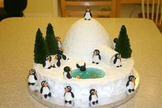 Penguin Winter Scene - Hands down my favorite cake.  Got the idea on this site (thanks!).  The penguins, fish and igloo tiles are fondant.  Trees are sugar cones.  Water is piping gel with blue food coloring. The igloo is the Wilton barbie doll cake pan (the dress). The cake was very time consuming but did not take much skill at all.