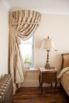 "Use curved cornice above dining room drapes. this continues ""circular"" theme and adds extra touch!"