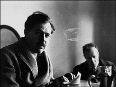 Robert Capa, Ernest Hemingway has Breakfast in his Hotel Room before leaving for the Front Lines, Valencia, Spain, 1937.