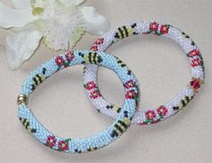 Bees & Blossoms Bracelet Pattern by Sharon Boehme!  Pick your favorite background color and crochet these delightful bees with colorful blossoms. Add a clasp ...