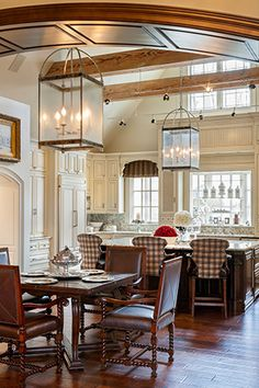 Joy Tribout Interior Design.  Touch of rustic with the beams.  Love the plaid detail.