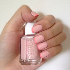 French manicure with a twist. Nude pink with neon coral tips!