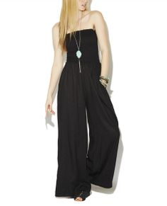 """One of our fave LBJ gives a free spirit kind of feeling, featuring a soft solid woven body, long smocked top, wide leg, and a pull on construction.  Model is 5'9"""" and wears a size small      32"""" Inseam     30"""" Leg Opening      100% Rayon     Hand Wash     Imported"""