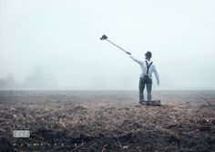 A villager on the field while trying to take selfie with his camera strapped  to selfi broom by Mariusz Warsinski on 500px