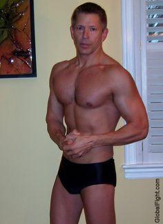 a buffed muscular jock muscle boy manly guys flexing