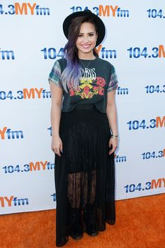 Demi Lovato looked so cool rocking a black hat and skirt with a  plaid-sleeved 10bc006dfc