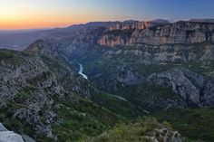 Photo of the Verdon River and the rugged cliffs of the Gorges du Verdon in Alpes de Haute Provence, France.