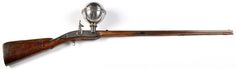 A ball over barrel muzzle loading air rifle, by I. C. SAPS, Berlin inscribed on the lock plate, 29in. octagonal re-browned two-groove rifled barrel with later ramrod under, fitted plain brass cover plate on left hand side, trigger guard missing, fitted cocking hammer, with lightly carved walnut stock (fore-end restored), fitted brass butt plate and tang, 43in. long overall.