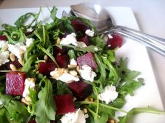 Beet Salad with Goat Cheese, Pine Nuts and Honey Walnut Vinaigrette dressing.