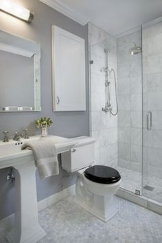 The paint color is Silver Dollar 1460 by Benjamin moore in an eggshell finish