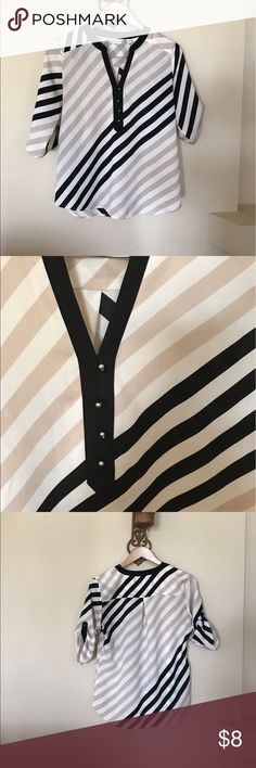 Tan white and black tunic Blouse Black white and tan tunic Blouse. Lightweight easy wash polyester fabric. Can be worn with many different accent pieces all year around. New York & Company Tops Tunics