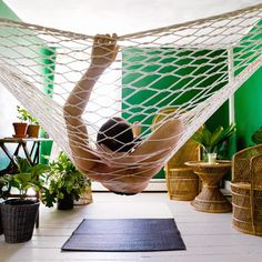 A convincing argument for hanging a hammock indoors.