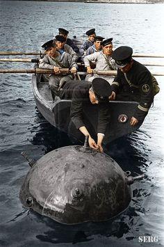 Soviet sailors disarming a mine.