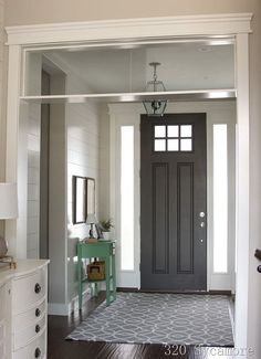 See how this little, green painted table has added a focal point in an otherwise neutral foyer.