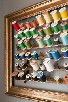 Elizabeth's Color-Filled Apartment — House Tour-like the frame around the spools of thread.... Cute idea for sewing room.