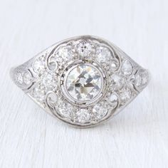 Gorgeous antique engagement ring centering an old European cut diamond!