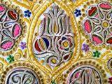 Detail nášivky zlatom zo sviatočnej šatky. Čataj (okr Senec), 1923. Depozitár ÚĽUV. Foto: O. Danglová