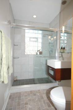 Grey porcelain tile was chosen for the floor shower walls for 1930 style bathroom ideas