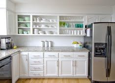 Take the doors off the top cabinets to make open shelving
