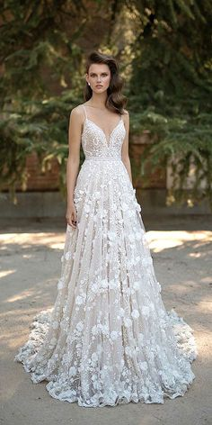 24 Floral Wedding Dresses That Are Incredibly Pretty ❤ See more: http://www.weddingforward.com/24-floral-wedding-dresses-incredibly-pretty/ #weddings #dress