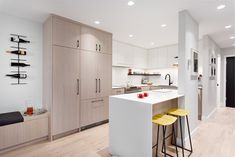 East avenue kitchen renovation by Madeleine Design Group in Vancouver, BC. Contemporary Design, Modern Design, Small Condo, Bright Walls, Banquette Seating, Oak Cabinets, Large Windows, Humble Abode, Design Firms
