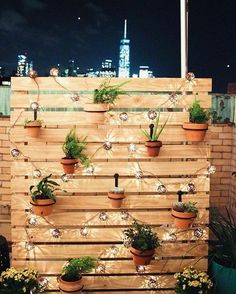DIY Outdoor Decor To Spruce Up Your Backyard - DIY outdoor privacy screen with string lights and hanging plants. DIY outdoor privacy screen with s - Backyard String Lights, Backyard Lighting, Outdoor Lighting, Landscape Lighting, Pathway Lighting, Garden Lighting Ideas, String Lighting, Garden Ideas, Fence Ideas