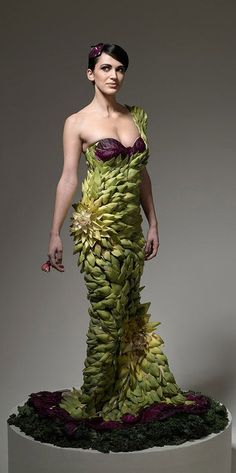 """""""Hunger Pains"""" is a series shot by photographer Ted Sabarese. The photos show models wearing clothing made of whatever food he/she was craving before they shot the photo, 15 designers, led by Ami Goodheart of SOTO Productions, were involved & each garment took hours to cook, create & assemble. The artichoke gown (seen here) was designed by Daniel Feld & Wesley Nault of Project Runway fame. It took over 6 hours to finish (the model stood the entire time while they attached each, individual…"""