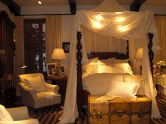 Ralph Lauren Safari Furniture | Mosquito netting and delicate white bed lines add romance to the Dutch ...