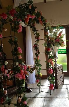 Looking beautiful, ready for the wedding ceremony. Bridal arch, urns on crates all filled with lots of flowery loveliness. www.am-flowers.co.uk