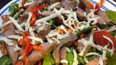 Steak and sweet pepper low carb salad...Leftover cooked steak (flank, ribeye, strip, etc)- About 1/4 lb per person  Thinly sliced sweet peppers (any color)  Baby Spinach or lettuce blend  Sliced Tomatoes  Grated Raw Organic Cheese (optional)