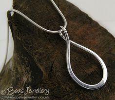 Twisted teardrop silver necklace - 18225f by Boo's Jewellery, via Flickr