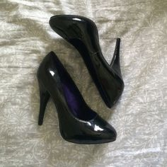 Black Pumps Great for interviews and or formal wear. Patent Black. Little wear. Bottom of the shoes in great condition! It's says 7.5 but I'm a 6.5-7 and it fits me perfect! Shoes Heels