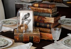 Skip flowers and take some of your favorite objects off the shelf for the table. (graphicsfairy.blogspot.com)