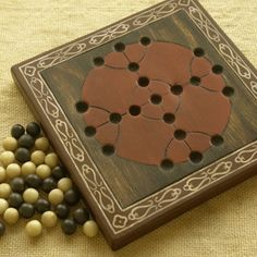 39 Ancient board games from around the world. These would be easy to convert to leather boards.