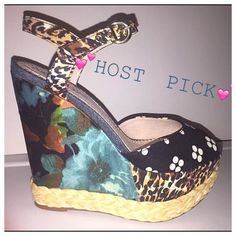 """LNWB WEDGE ONLY WORN 1x TOO CUTE SOLE OBSESSION Exude an exotic vibe in the Cathice-08 wedges from Sole Obsession. Florals and animal prints on this gorgeous wedge sandal will brighten your style.  Leopard and flower print fabric upper Braided raffia trim Ankle strap with adjustable buckle Round peep toe 2"""" platform, 5¼"""" floral print wedge Synthetic sole Imported Sole Obsession Shoes Wedges"""