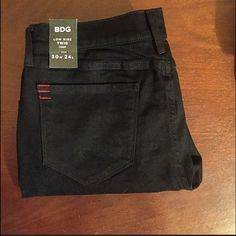 NWTUrban Outfitter BDG black crop jeans NWT! Never worn and no flaws. The model is wearing them in the picture, just a different color. These are all black, no detailing. High quality-I have them in my size. Selling these for a friend. Urban Outfitters Pants Skinny
