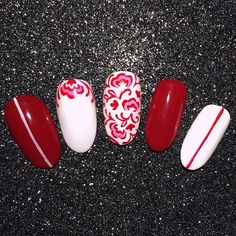 "This year I'm doing my #31DC2016 nail art on plastic nail tips! There's info about why I'm doing it this way on my blog, but the really good news is that I'm doing video tutorials for them whenever I can!  Here is my ""Red Nails"" prompt manicure. It is painted freehand using: ❤️ Presto White gel ❤️ @opi_products Amore On the Grand Canal GelColor ❤️ @akzentz Gel Play art paint in Red and White ❤️ @nailbees art brushes in Small and X-Small  Stay tuned for the tutorial video!"