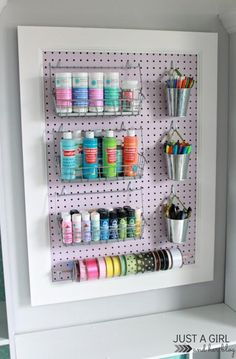 See how JustaGirlandHerBlog.com transformed a remnant pegboard with paint and baseboard molding to create a handy and attractive crafts storage unit. | thisoldhouse.com
